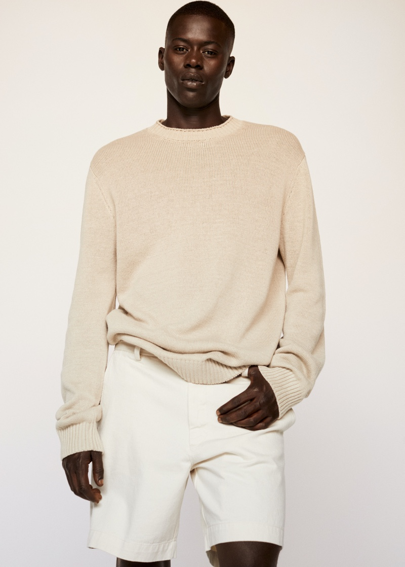 Embracing neutrals, Alpha Dia wears a knit sweater with shorts from Mango.