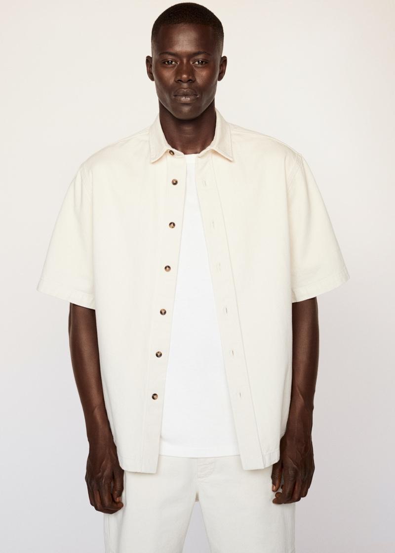 Showcasing matching style, Alpha Dia wears Mango Man.