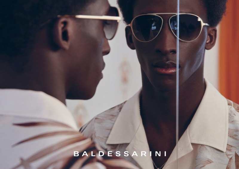 Amadou dons sleek sunglasses for Baldessarini's spring-summer 2022 campaign.