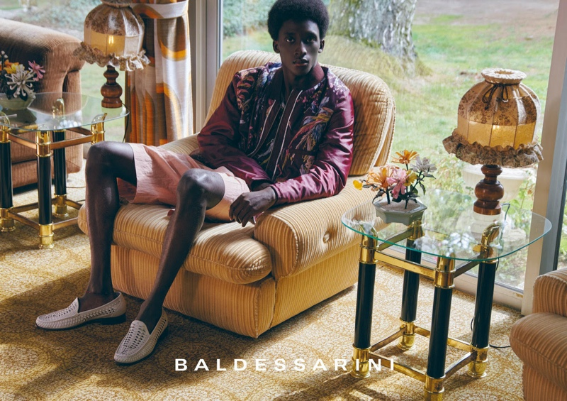 Embracing wine-colored hues, Amadou makes quite the fashion statement in Baldessarini's spring-summer 2022 campaign.