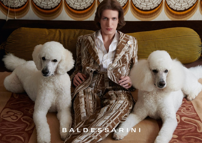 Donning a patterned suit and posing with poodles, Xavier Buestel stars in Baldessarini's spring-summer 2022 campaign.