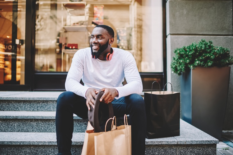 Black Man Bags Clothes Shopping Stairs