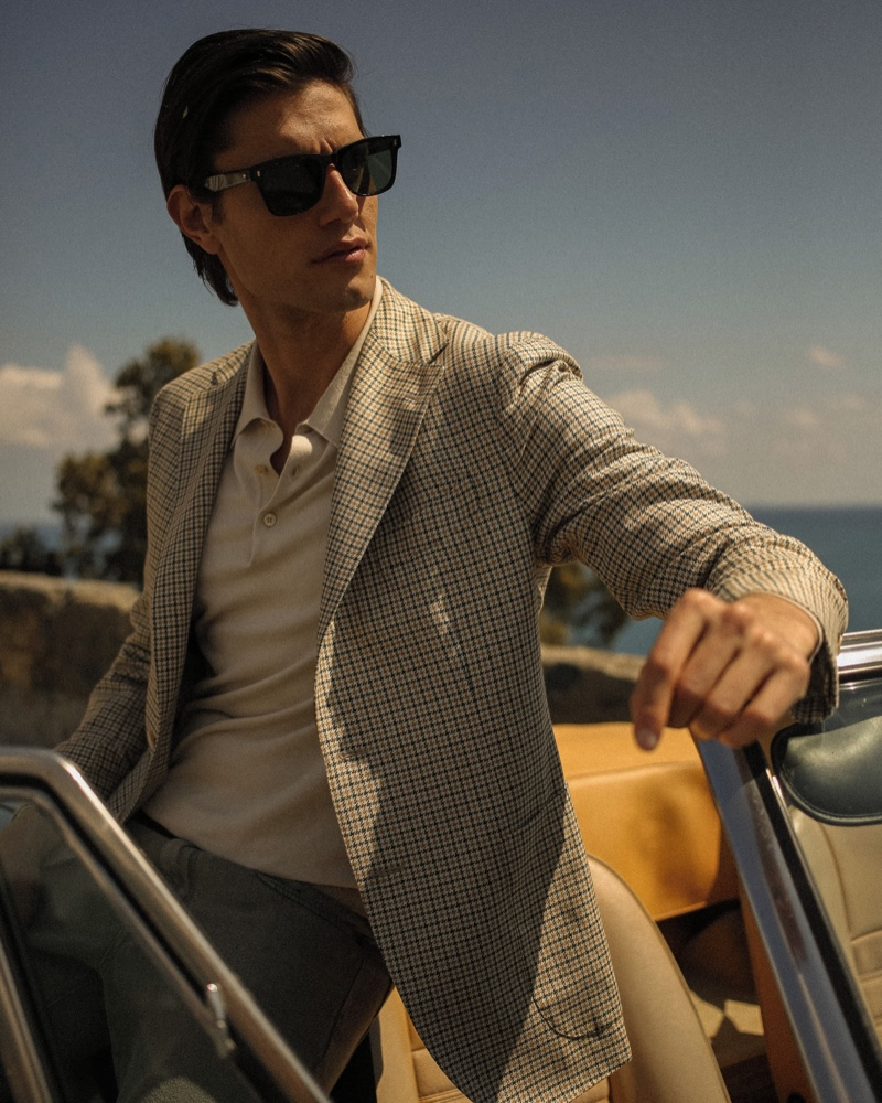 Modeling a checked jacket, Marco Castelli appears in Boglioli's summer 2021 campaign.