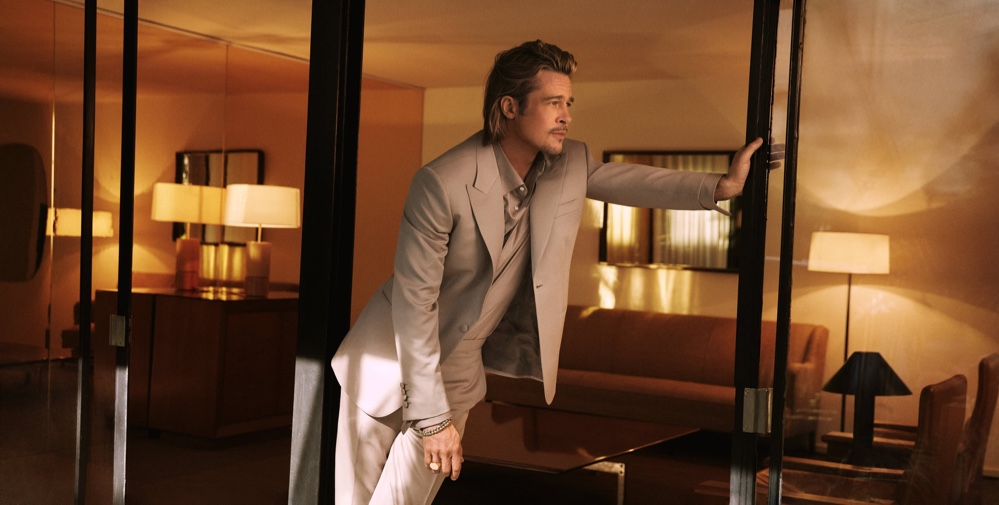 Brad Pitt dons a dusty pink sustainable virgin wool tuxedo with a silk evening shirt for Brioni's fall-winter 2021 campaign.
