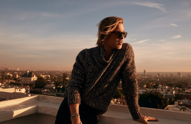 Photographed on a rooftop, Brad Pitt wears a Brioni black and white cashmere and silk turtleneck sweater with Havana vintage shape sunglasses for the brand's fall-winter 2021 campaign.