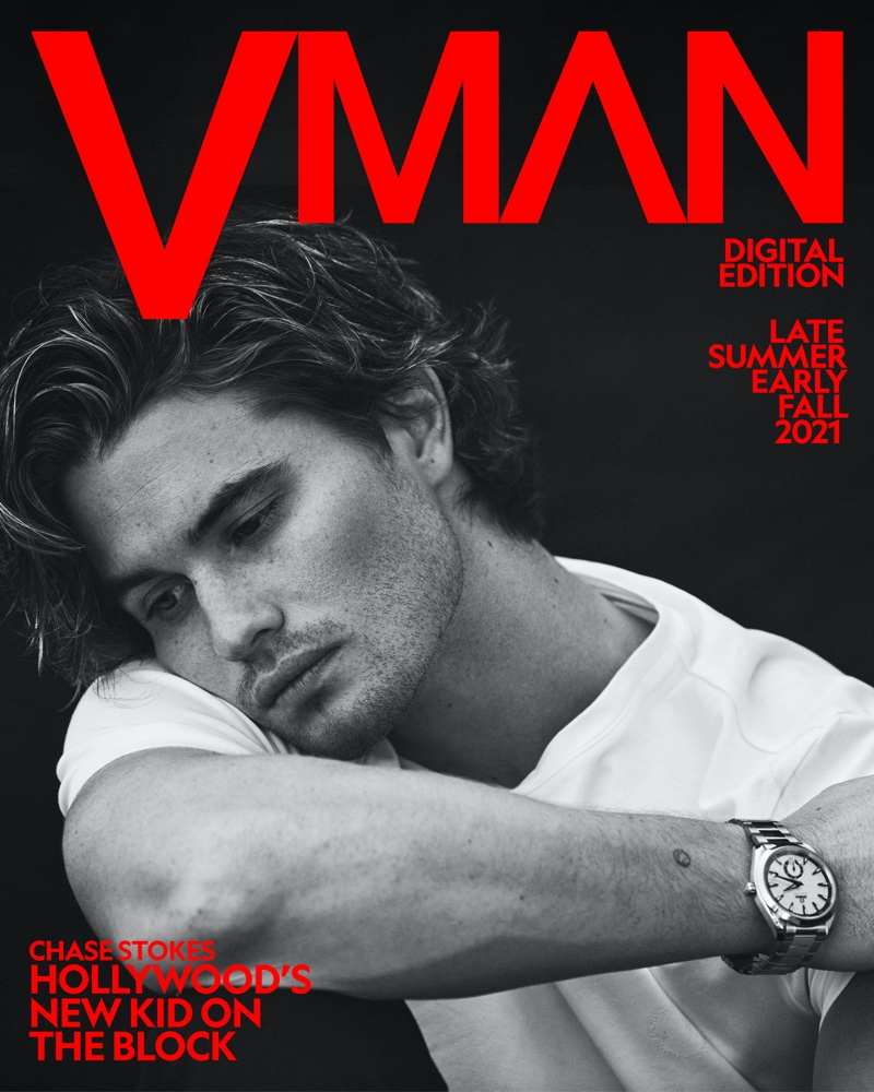 Appearing in a black and white photo for VMAN, Chase Stokes wears an Armani Exchange t-shirt with an Omega Seamaster Aqua Terra Small Seconds watch.