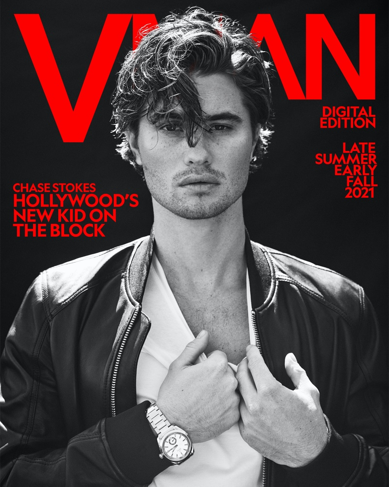 Front and center, Chase Stokes rocks an Armani Exchange bomber jacket and t-shirt with an Omega Seamaster Acqua Terra Small Seconds watch for VMAN.