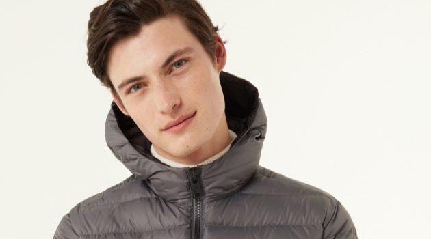 Gabriel Daum stays warm in a Colmar Originals sporty hooded down jacket in grey.