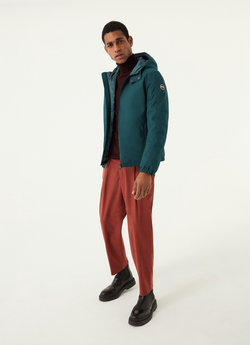 Angelo Gomez wears Colmar Originals' opaque stretch down jacket with hood in green.