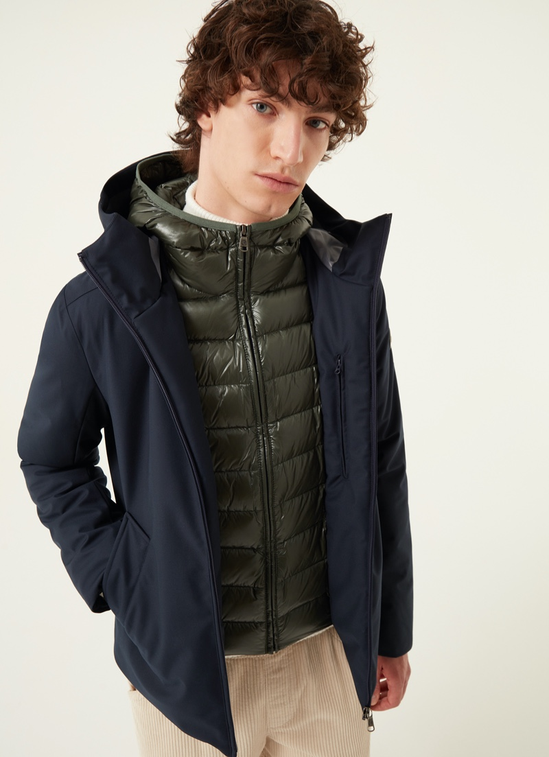 Front and center, Oliver Bartha models Colmar Originals' 3-layer down jacket with water-repellent wool effect in blue.