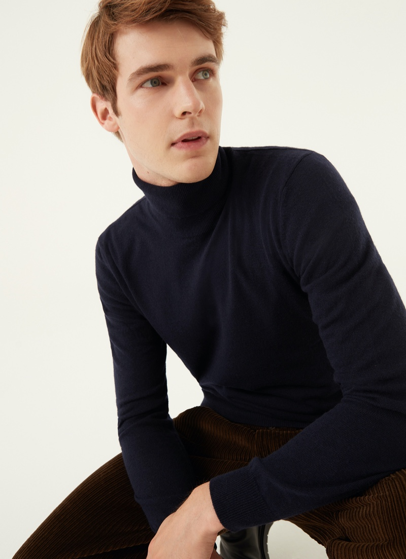 Max Lusth is a smart vision in a Colmar Originals wool and cashmere blend turtleneck in blue.