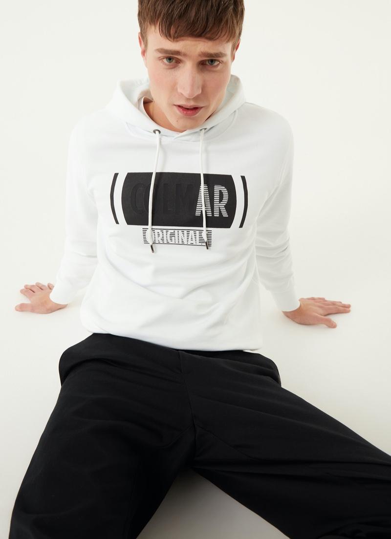Marco De Sario goes casual in Colmar Originals' sweatshirt with crossed out writing.