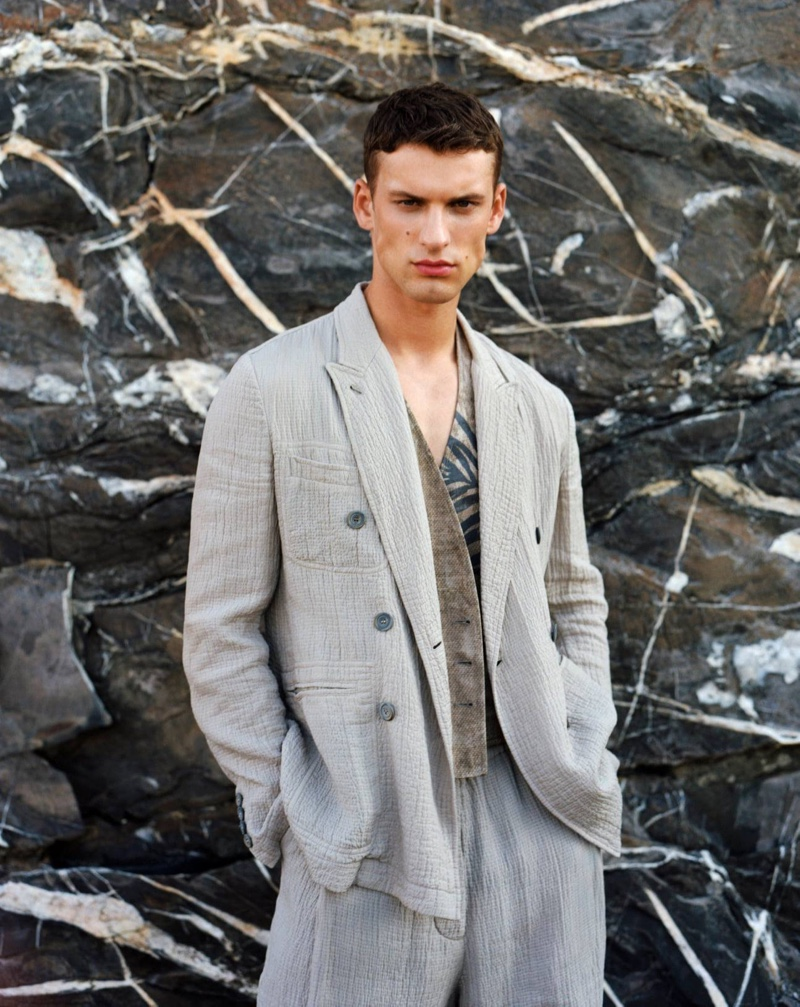 Reuniting with Giorgio Armani for its summer 2021 men's campaign, David Trulik is a chic vision in lightweight tailoring.