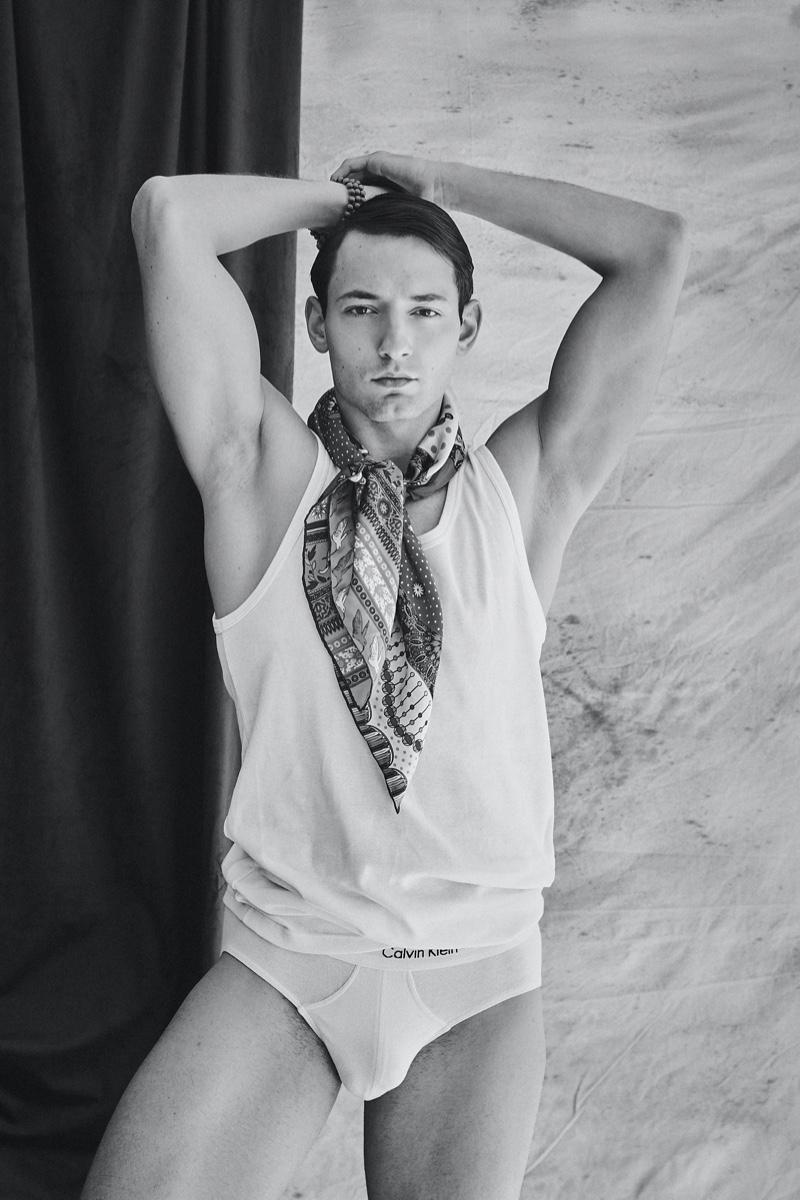 Guille wears scarf Prada, bracelet Bodhi Mala, tank and underwear Calvin Klein.