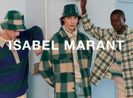 Models Fernando Lindez, Freek Iven, and Alpha Dia sport fall-winter 2021 looks from Isabel Marant.
