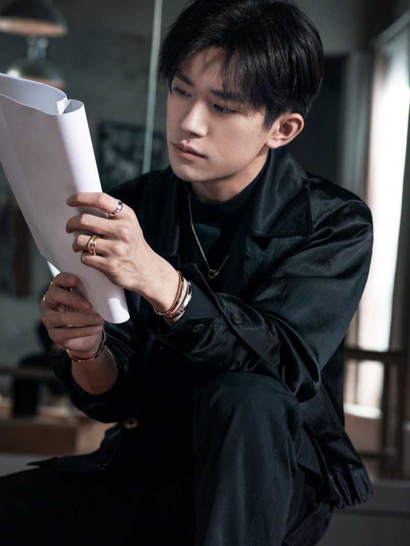 Clad in Tiffany & Co. jewelry, Jackson Yee stars in a new campaign, wearing the brand's Atlas X rings and bracelets with a necklace.