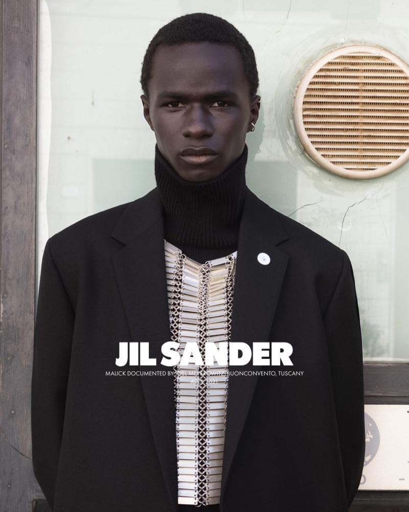 Malick Bodian fronts Jil Sander's fall-winter 2021 men's campaign.
