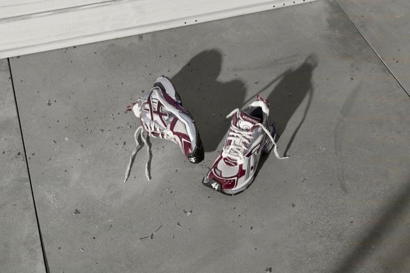 Balenciaga Runner Sneaker in white, dark red, grey, and black.