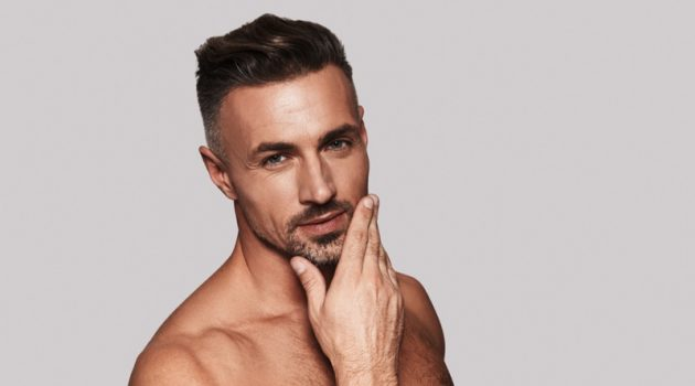 Male Model Touching Face Skin 40s