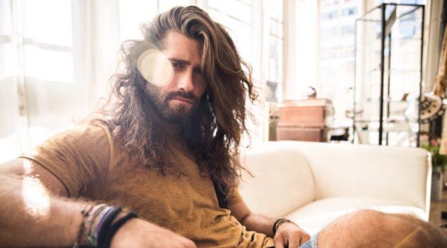 Man Long Hair Sitting Couch Sun Summer