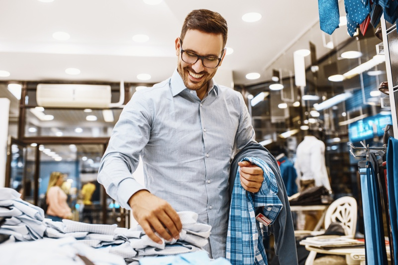 Man Smiling Shopping Clothes Store