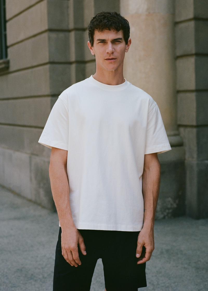 Vincent Lacrocq wears a simple white t-shirt with shorts from Mango Man's Leisure collection.