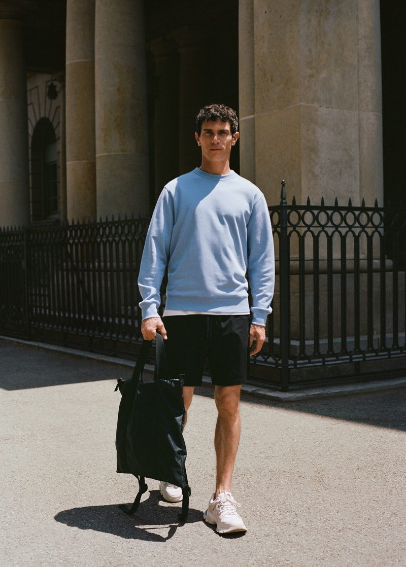 Stepping outside, Vincent Lacrocq models a sweatshirt with shorts from Mango Man's Leisure collection.