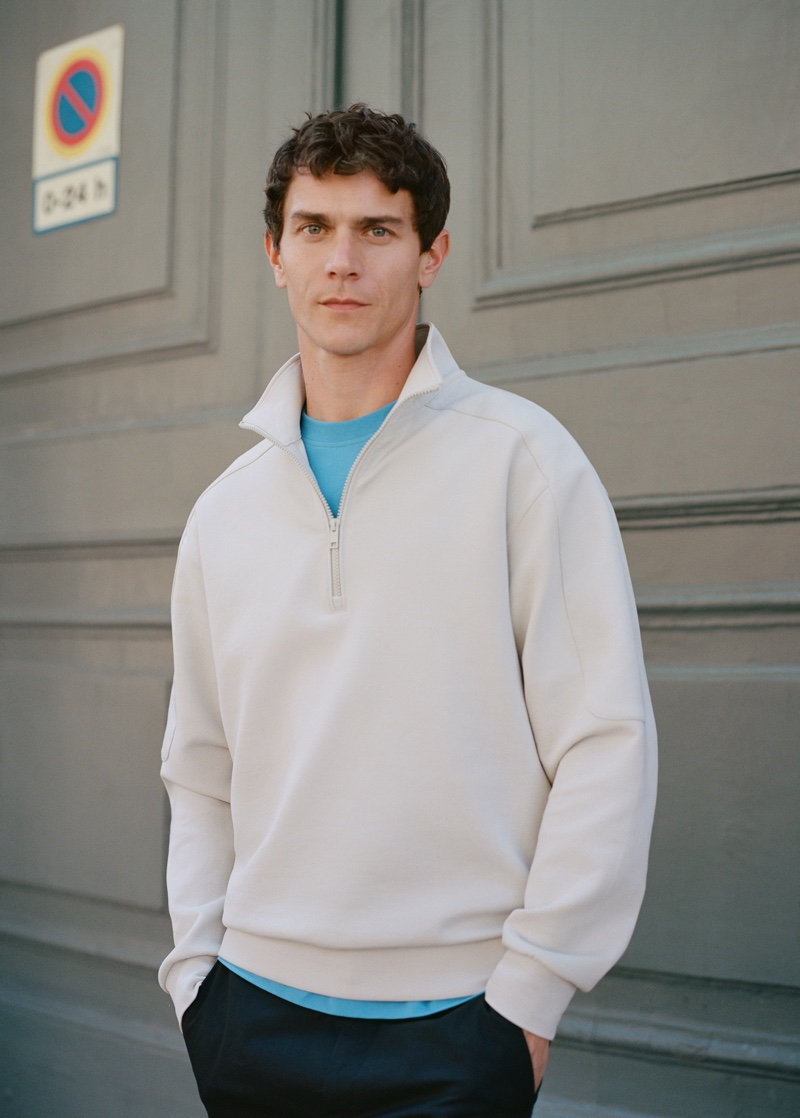 Front and center, Vincent Lacrocq sports a half-zip pullover from Mango Man's Leisure collection.