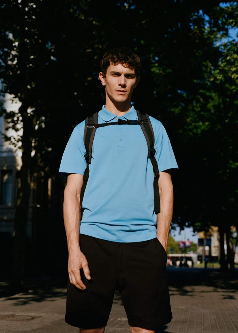 On the move, Vincent Lacrocq wears a polo shirt and shorts from Mango Man's Leisure collection.