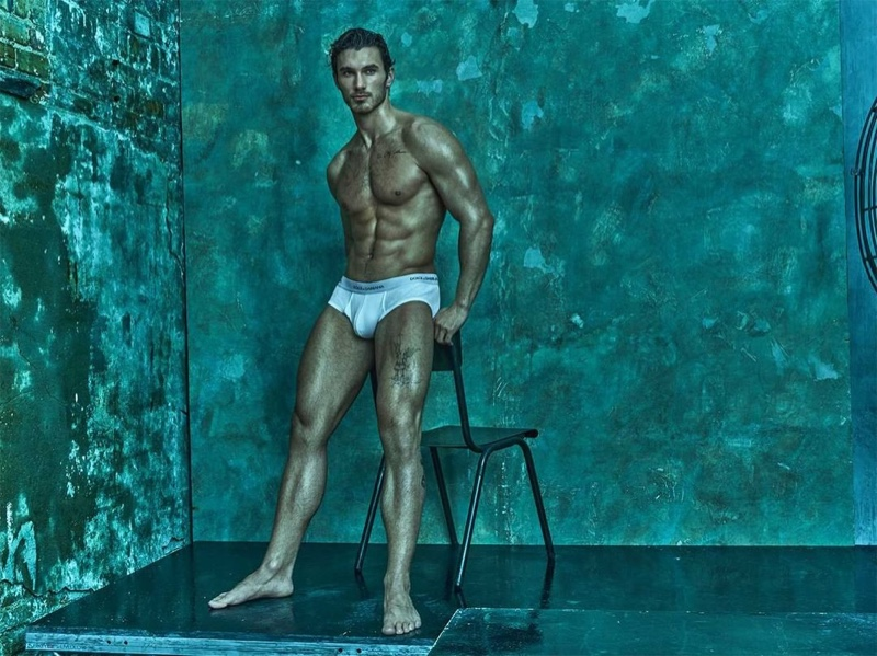 Donning white underwear briefs from Dolce & Gabbana, Michael Yaeger appears before photographer Mariano Vivanco.