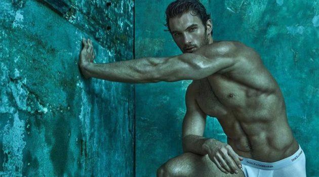 Stretching, Michael Yaeger models white Dolce & Gabbana underwear.