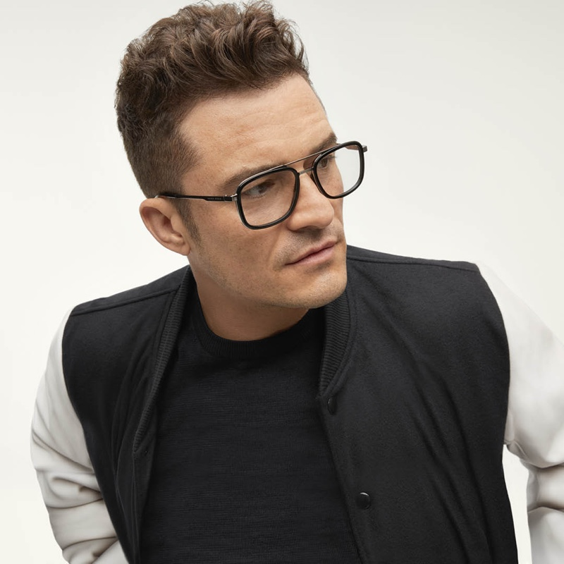 Orlando Bloom dons black framed glasses for BOSS's eyewear campaign.