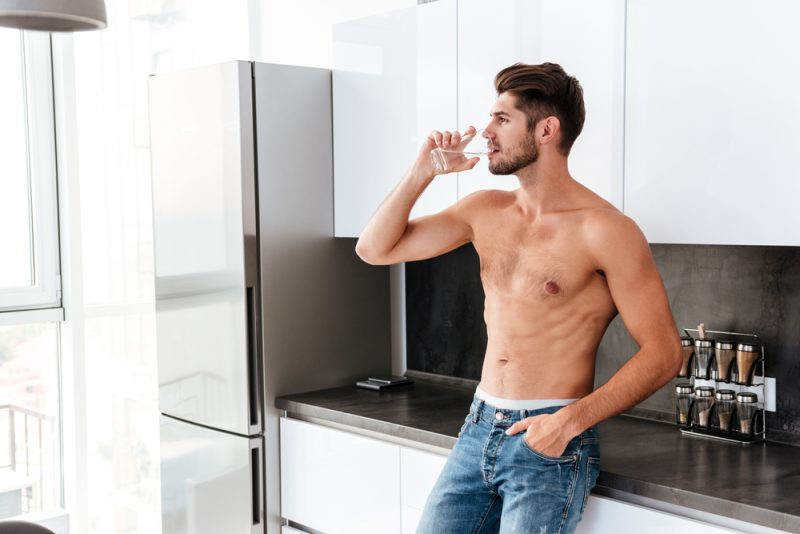 Shirtless Male Model Drinking Water