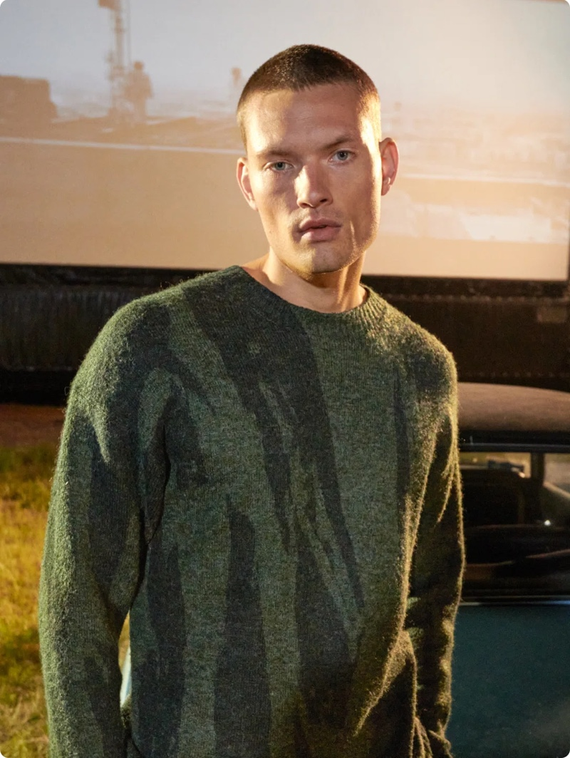 Front and center, William Los wears a Kenzo sweater for Stylebop.