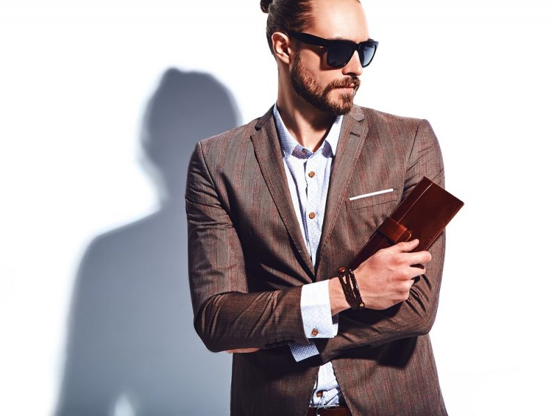Stylish Man with Wallet Bracelet and Sunglasses