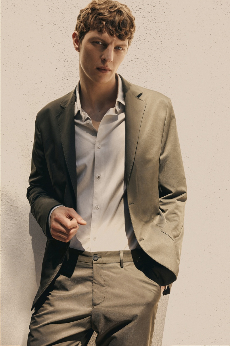 Donning a leisure suit, Tim Schuhmacher fronts a new editorial from Massimo Dutti.