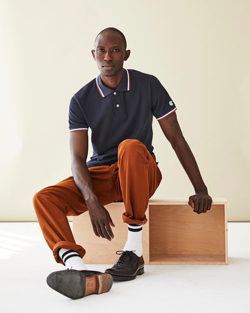 Embracing fall tones, Armando Cabral wears a Todd Snyder polo with relaxed pants.