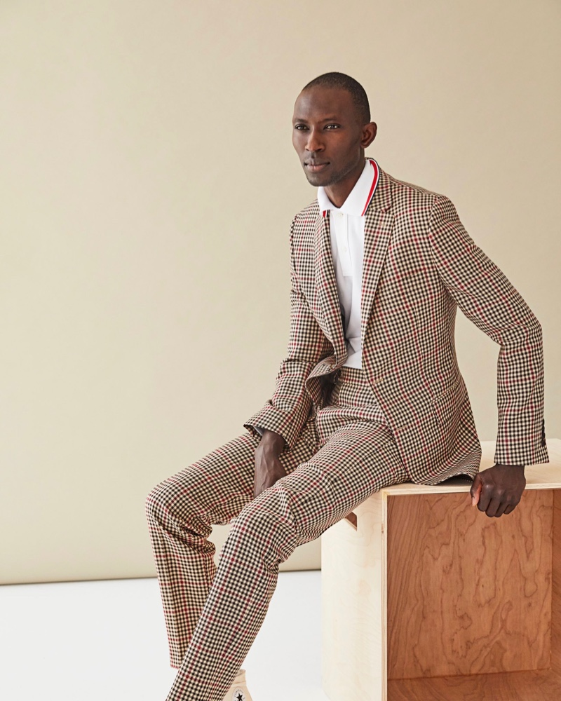 Making a case for dapper suiting, Armando Cabral models a gingham print suit with a white polo shirt from Todd Snyder.
