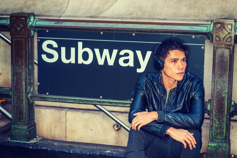 Young Man Leather Jacket Subway Sign