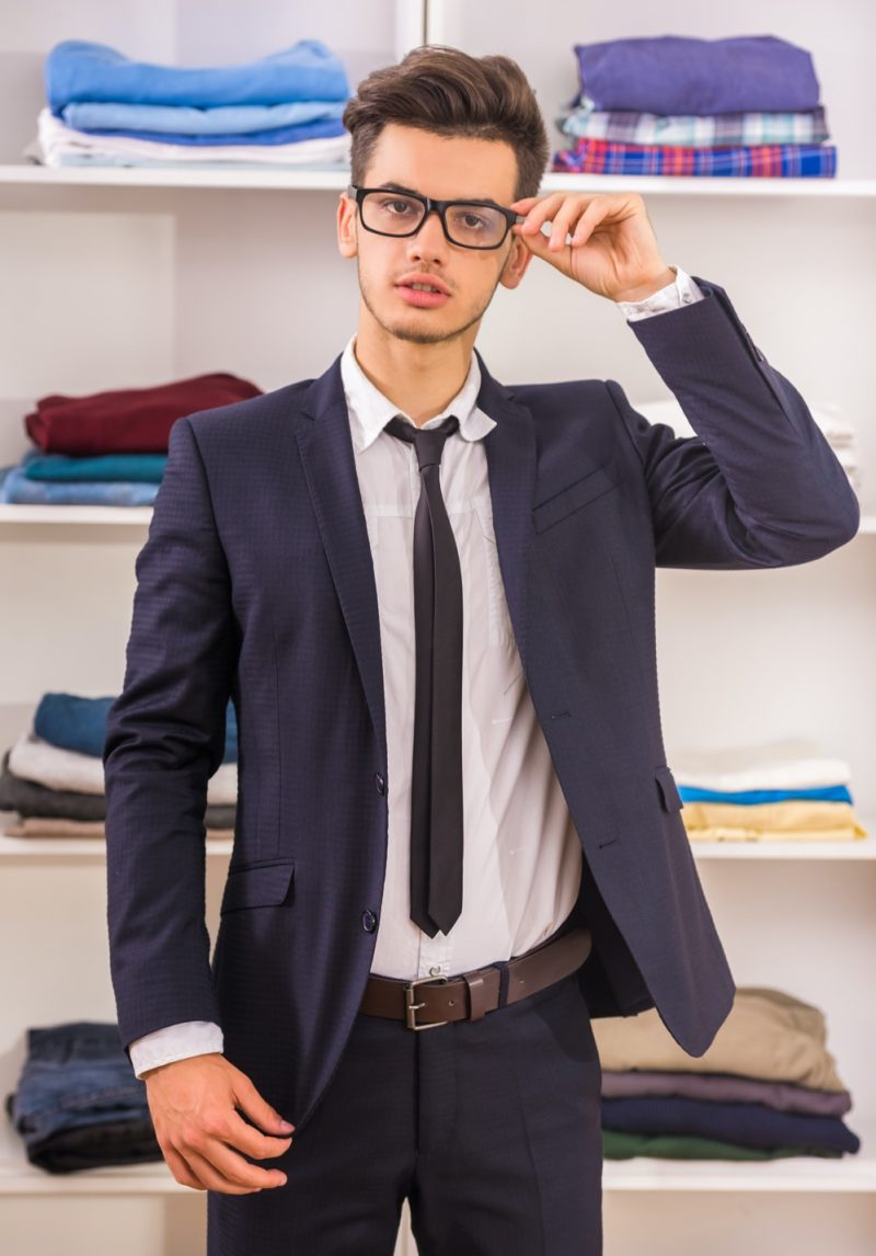 Young Man Wearing a Suit and Glasses
