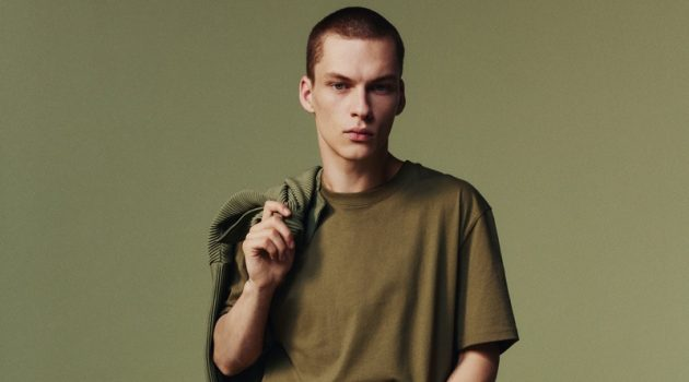 Andreas wears a pleated oversized top with pants from Zara.