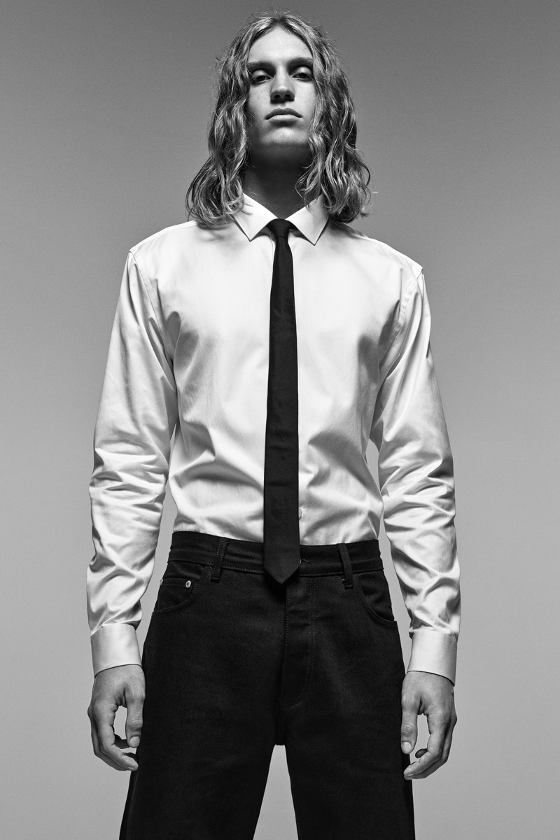 Front and center, Caleb Altice dons a dress shirt and tie with Zara's straight fit jeans.