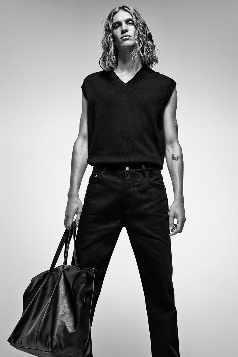 Making a style statement in black, Caleb Altice models Zara's knit v-neck vest.