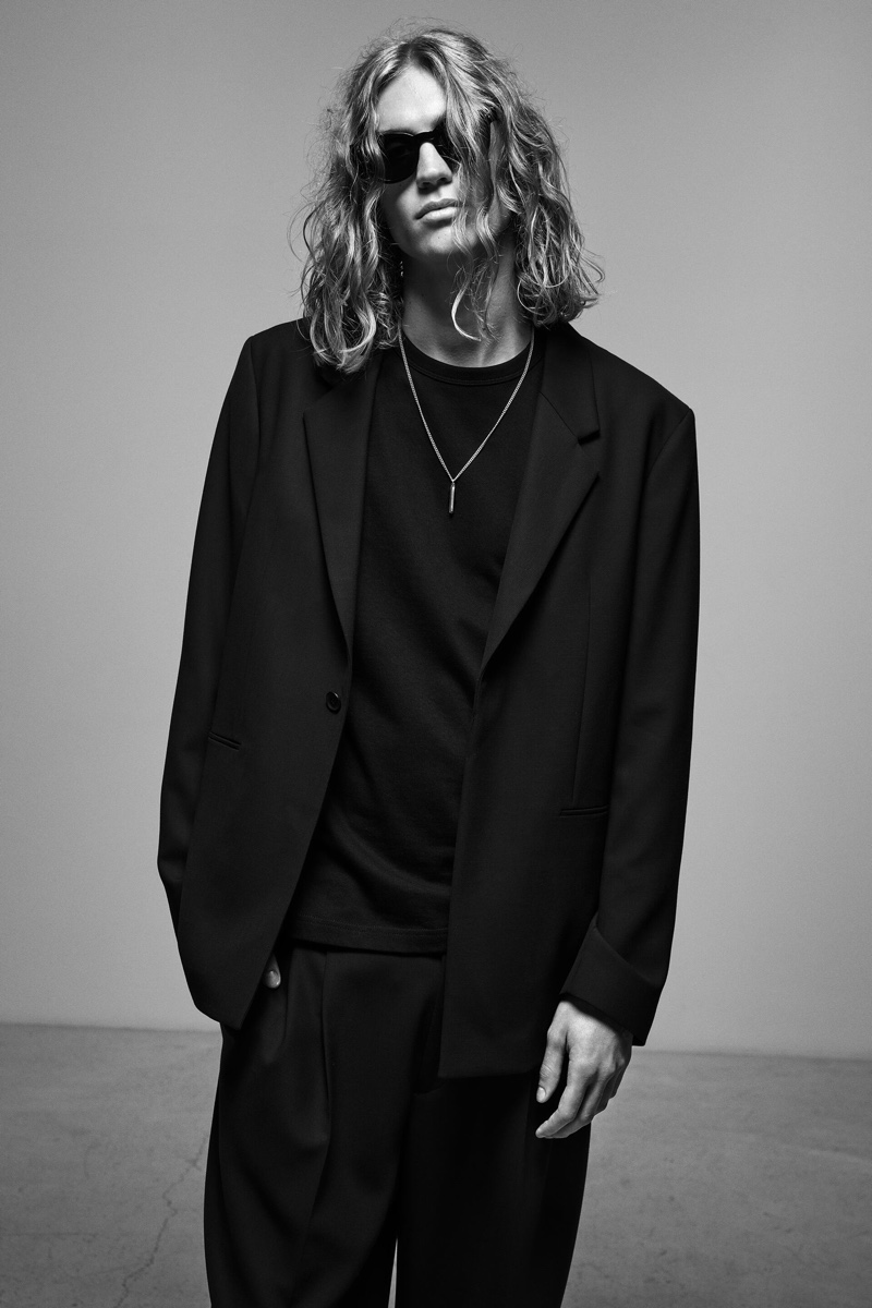 Caleb Altice sports a relaxed black suit jacket from Zara's Join Life collection.