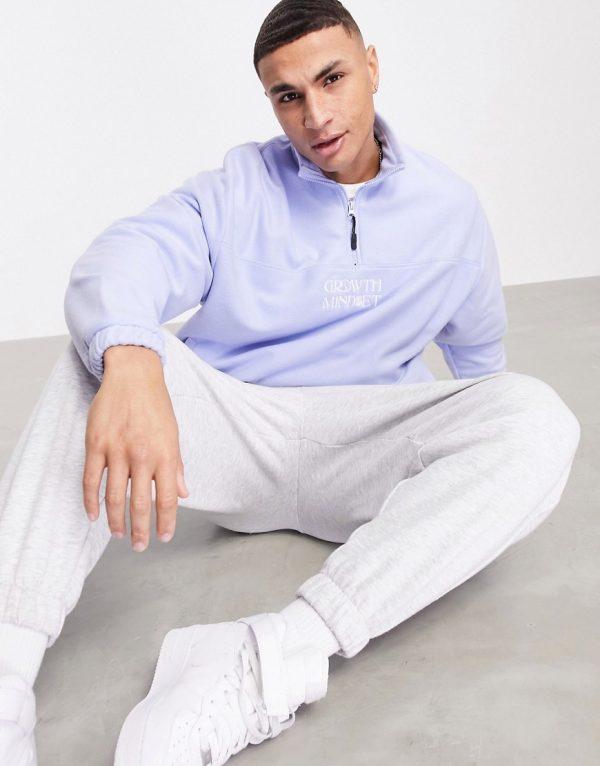 ASOS DESIGN oversized polar fleece logo sweatshirt with half zip in pastel blue-Blues