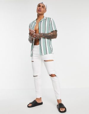 ASOS DESIGN skinny jeans in white with rips and raw hem