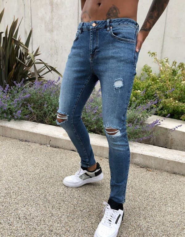 ASOS DESIGN spray on'vintage look' jeans with power stretch in dark wash blue with abrasions-Blues
