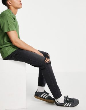 ASOS DESIGN stretch tapered jeans in washed black with rips