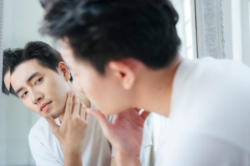 Asian Man Checking Face Mirror