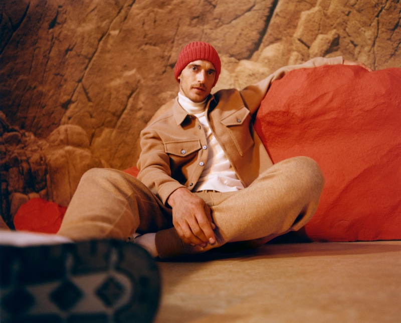 Clément Chabernaud dons a tan colored jacket and joggers with a turtleneck for BOSS's fall-winter 2021 men's campaign.